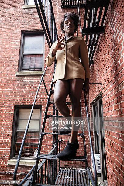 young transgender woman on the fire stair - black transvestite stock pictures, royalty-free photos & images