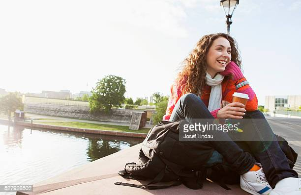 Young traveler enjoying coffee to go.