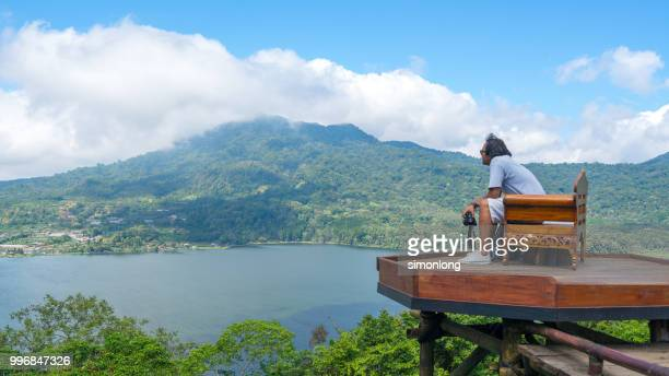 Young traveler man observing beautiful landscape. Bali, Indonesia.