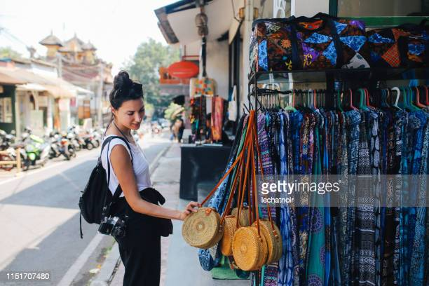 young traveler shopping in ubud, bali, indonesia - bali stock pictures, royalty-free photos & images