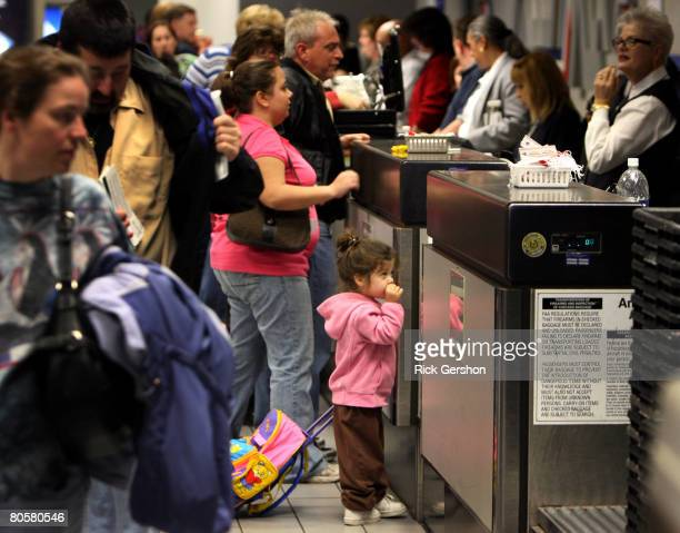A young traveler waits at the ticket counter April 9 2008 at the Dallas Fort Worth International Airport in Irving Texas American Airlines canceled...