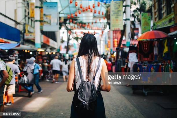 young traveler woman in kuala lumpur chinatown district - malaysia stock pictures, royalty-free photos & images