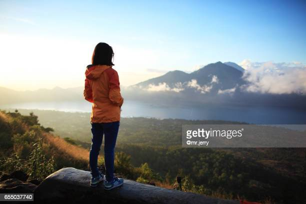 Young traveler woman observing beautiful landscape