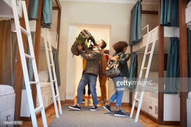 young travelers coming in hostel - hostel stock pictures, royalty-free photos & images