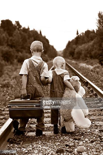 young travelers - orphan stock pictures, royalty-free photos & images