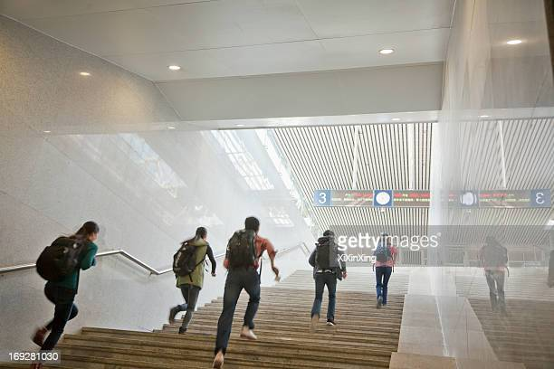 young travelers running up the stairs - steps and staircases stock pictures, royalty-free photos & images