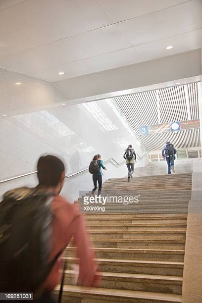 Young Travelers Running Up the Stairs