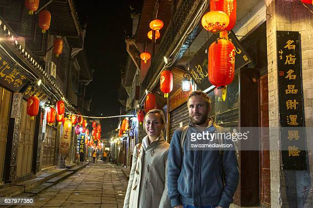 Young traveling couple in ancient village of China