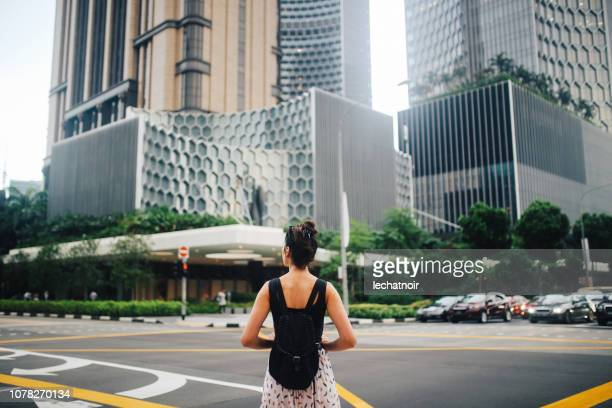 young traveller woman exploring the amazing singapore - asia pac stock pictures, royalty-free photos & images