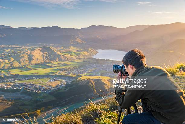 Young travler taking photo at queen town  in new zealand