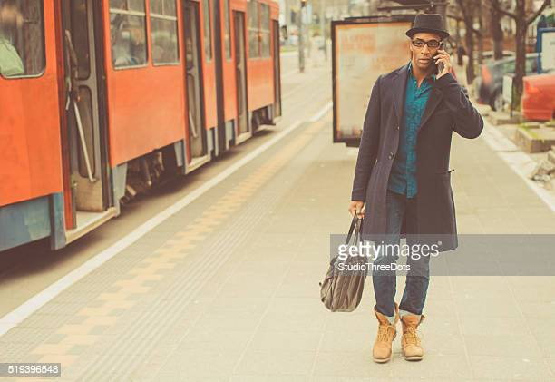 Young trendy man on the mobile phone