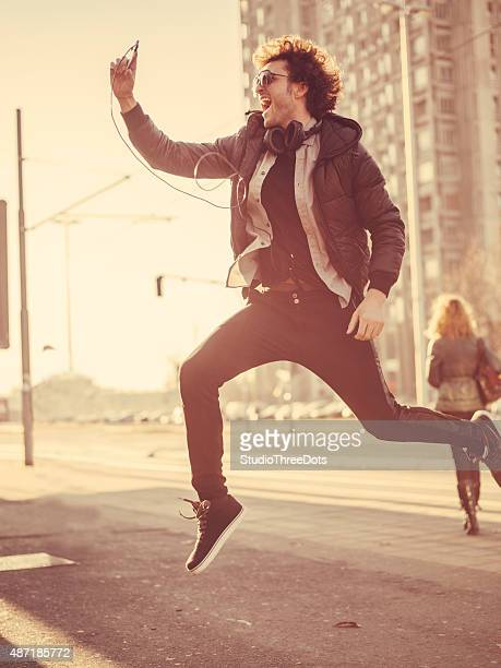 young trendy man taking selfie - leap day stock pictures, royalty-free photos & images