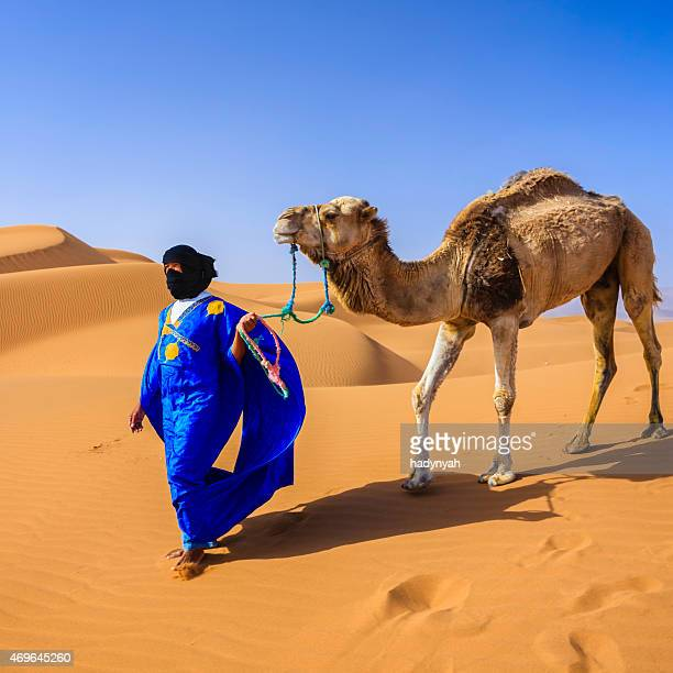 Young Tuareg with camel on Western Sahara Desert in Africa