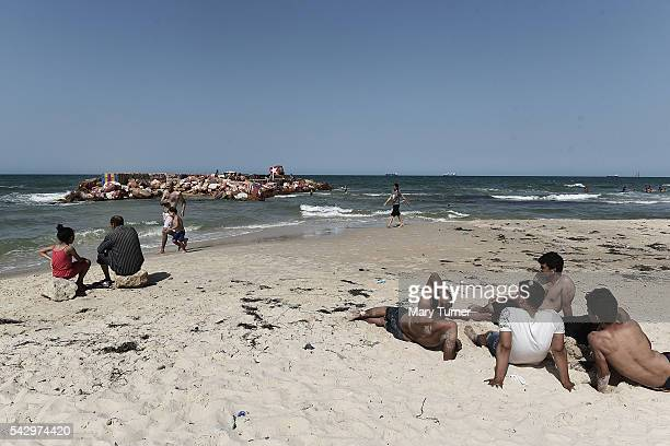 Young Tunisians enjoy the quiet of the once popular beaches in Sousse in the North of Tunisia where the country's tourism industry has fallen into a...