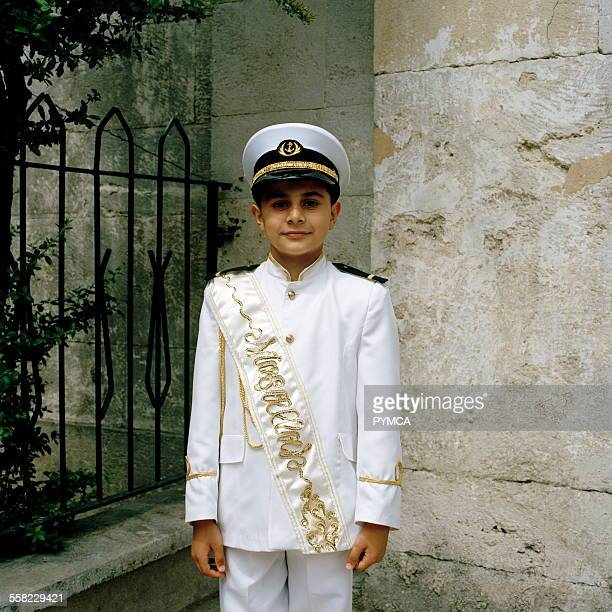 Young Turkish boy in ceremonial circumcision outfit in Istanbul Turkey