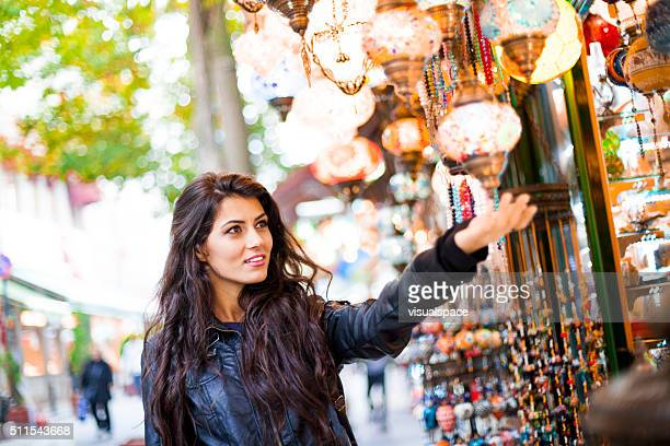 Young Turkish Woman Shopping For Street Goods