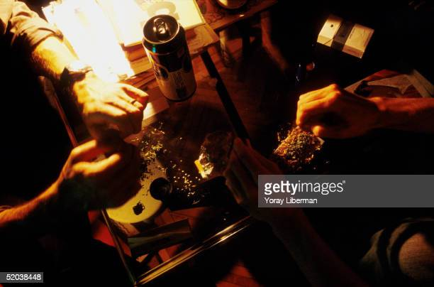 GALATASARAY ISTANBUL TURKEY SEPTEMBER 2003 Young Turks roll joints at friends place before going out September 2003in Galatasaray Istanbul Turkey The...
