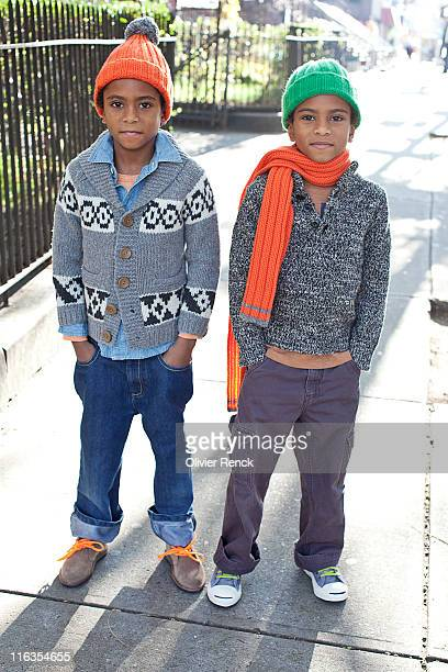 Young twin boys posing for a portrait in Harlem, New York.