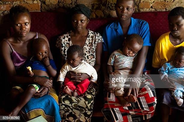Young Ugandan mothers wait patiently to visit the community health promoter Despite determined global progress in reducing child deaths an increasing...