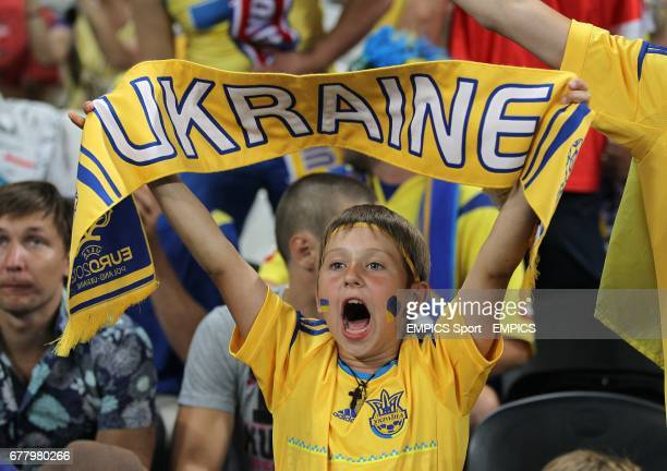 A young Ukraine fan in the stands