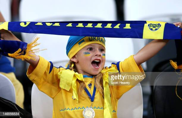 A young Ukraine fan soaks up the pre match atmopshere during the UEFA EURO 2012 group D match between England and Ukraine at Donbass Arena on June 19...