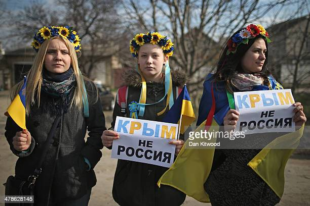 Young Ukrainian women hold signs that read 'Ukraine not Russia' during a protest against the forthcoming referendum in Crimea on March 14 2014 in...