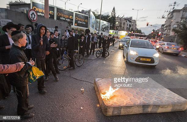 Young ultraOrthodox Jews burn a mattress in order to block a street during a protest against ultraOrthodox young men being called up for military...