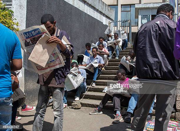 Young unempolyed persons look for jobs in newspapers on October 12 2015 in Addis Abeba Ethiopia