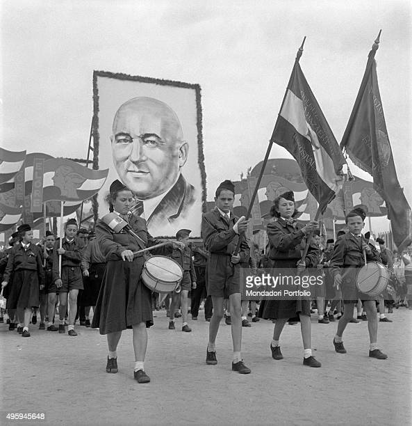 Young Ungarian people parading under the image of the Chairman of the Ungarian Communist Party Matyas Rakosi for the World Festival of Youth and...