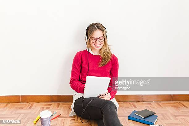 Young university girl studying at home.