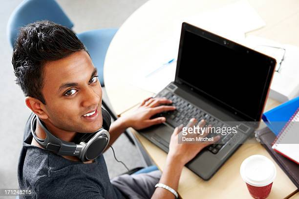 Young university student researching information