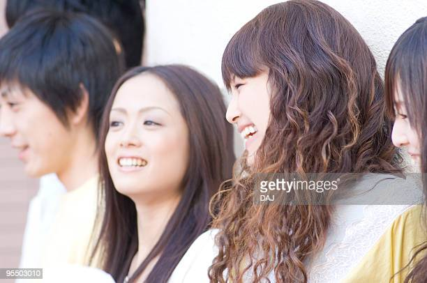 Young university students in campus, smiling