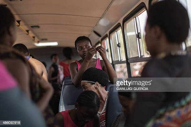Young unmarried Swazi women prepare in a bus for the last day of the annual royal reed dance at the Ludzidzini Royal palace on August 31 2015 in...
