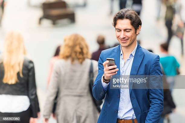 Young urban entrepreneur texting