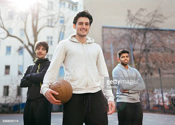 Young Urban Soccer Players Looking At Camera