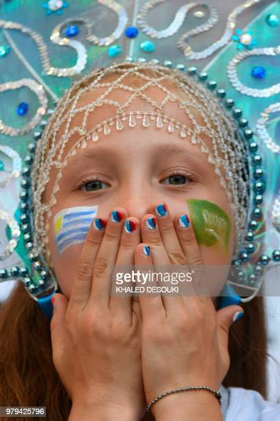 A young Uruguay fan cheers in the crowd before the Russia 2018 World Cup Group A football match between Uruguay and Saudi Arabia at the Rostov Arena...