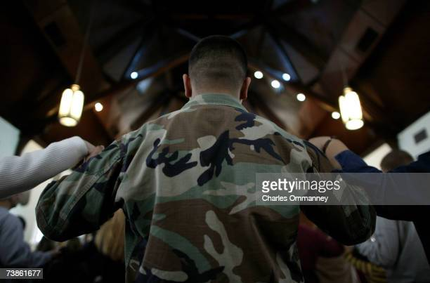 Young US Army soldiers attend a Sunday morning Catholic service February 02 2003 on base at Fort Levinworth in Kansas The soldiers are being...