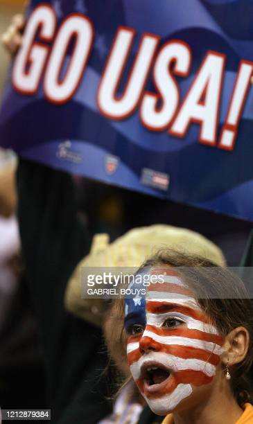 Young US fan looks watches on April 11 during the USA-France quarterfinal tennis match of the Davis Cup World Group in Winston Salem, North Carolina....