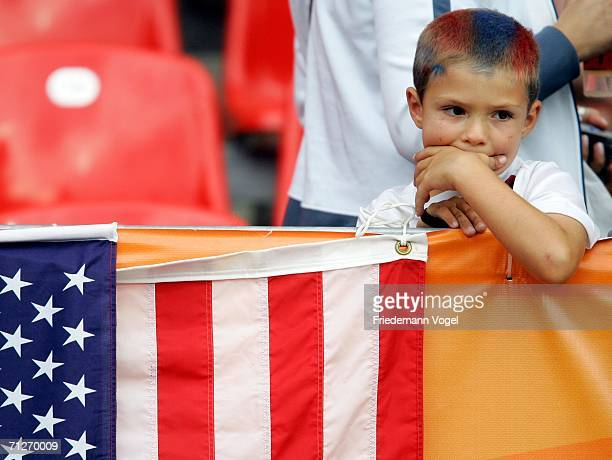 A young USA fan looks disappointed after his team's loss to Ghana at the FIFA World Cup Germany 2006 match between Ghana and USA played at the...