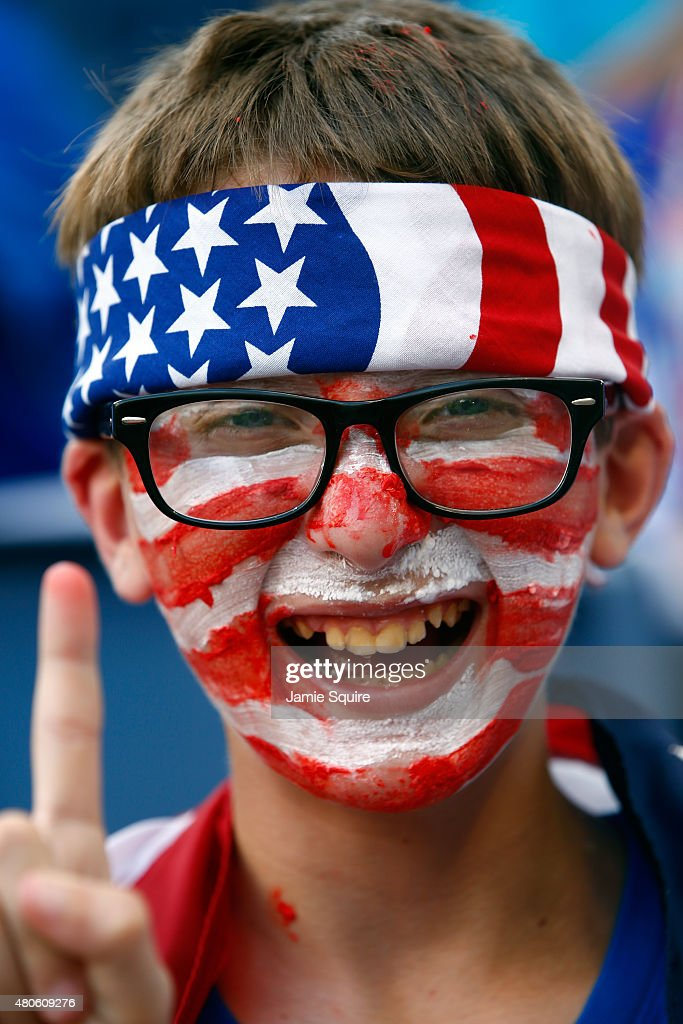A young USA fan poses for a photo prior to the CONCACAF Gold Cup match between Panama and the USA at Sporting Park on July 13, 2015 in Kansas City, Kansas.