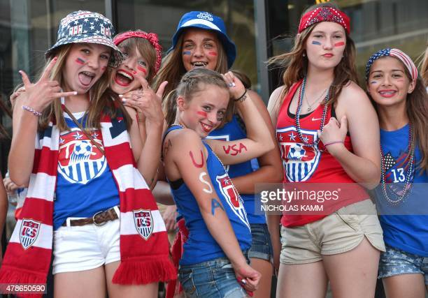 Young USA fans pose before a 2015 FIFA Women's World Cup quarterfinal match against China at Lansdowne Stadium in Ottawa, Ontario on June 26, 2015....