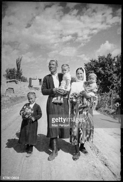 Young Uzbek family on village road, 1930s, Uzbekistan.