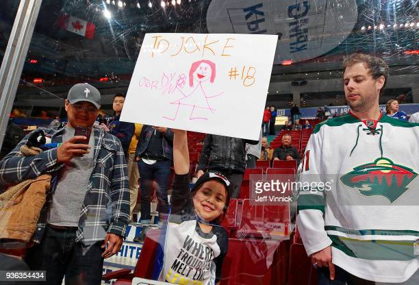 A young Vancouver Canucks fan holds up a sign for Jake Virtanen of the Vancouver Canucks during their NHL game against the Minnesota Wild at Rogers...