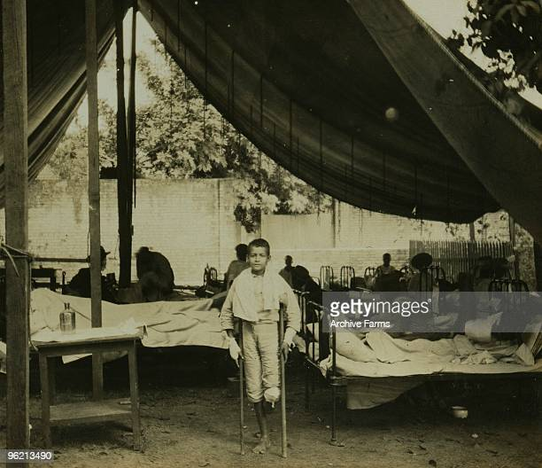 A young victim of the tragic earthquake which struck Kingston Jamaica on January 14 1907 By Griffith Griffith