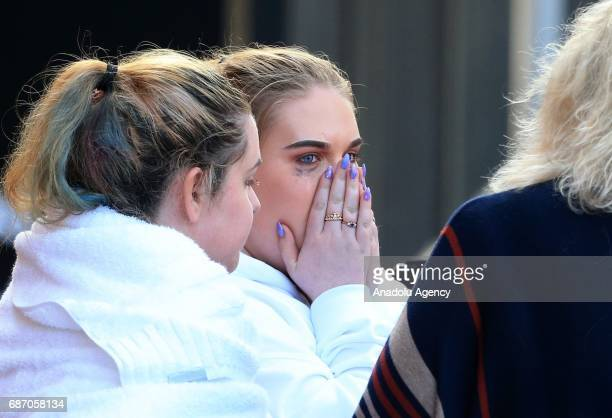 Young victims look visibly distressed as they leave the Park Inn hotel that tookin victims from the Manchester Arena stadium in Manchester United...