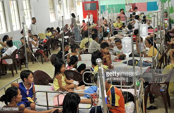 Young victims of dengue fever crowd the children's ward of the governmentrun Quirino Memorial Hospital in Manila on September 11 2010 An upsurge of...