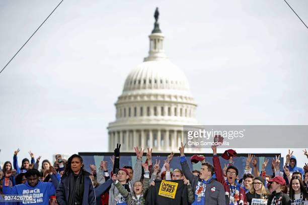 Young victims of gun violence including students from Marjory Stoneman Douglas High School stand together on stage at the conclusion of the March for...