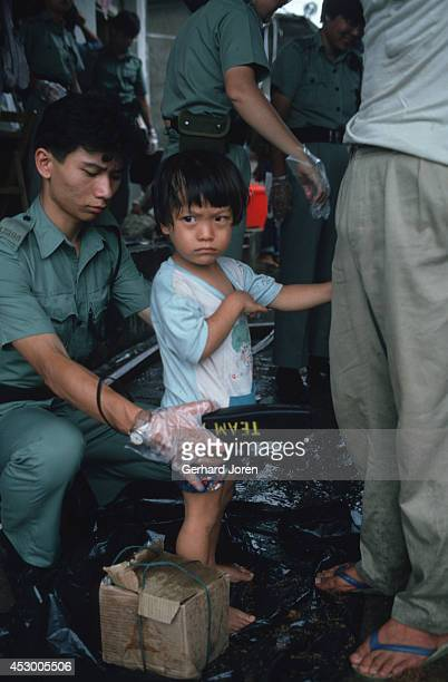 A young Vietnamese boat refugee being screened on arrival in Hong Kong More than 200000 Vietnamese refugees arrived by boat in Hong Kong during the...