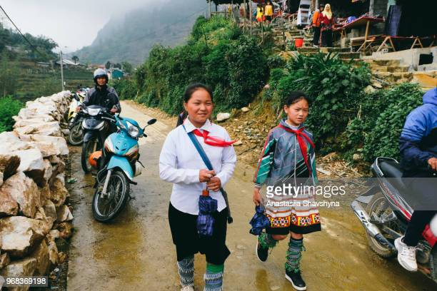 young vietnamese girls walks from school in sa pa, vietnam - sa pa stock photos and pictures
