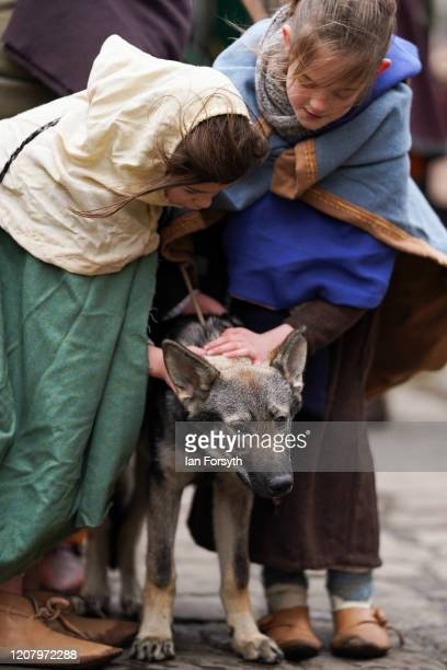 Young Viking reenactors stroke a dog as they wait to march through York during the 36th York Viking Festival on February 22 2020 in York England The...